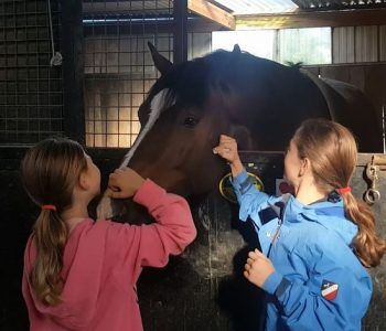 He loves the kisses on the muzzle